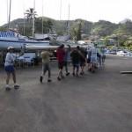 Volunteers stowing a freshly pulled mast.