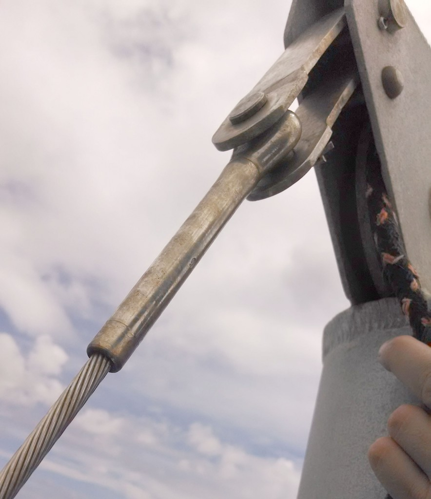 The black halyard leading aft out of the mast head